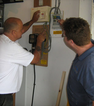 An image of two men checking some equipment