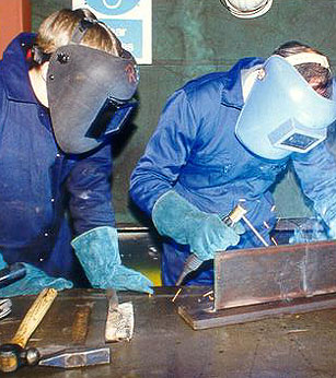 Image of two people welding